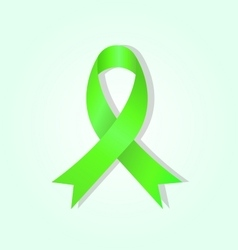 Green awareness ribbon on green glow background vector