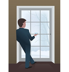 Businessman looking out the window vector