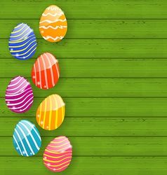 Easter colorful eggs on wooden texture vector