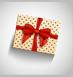 Realistic gift box with red ribbon isolated vector