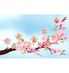 Fairies flying on blossom branch vector