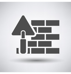 Brick wall with trowel icon vector