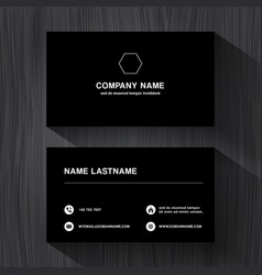 black paper business namecard on a black wood vector image vector image