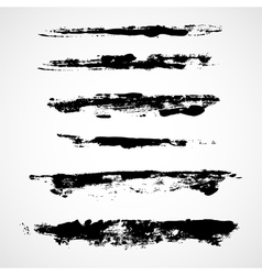 A set of grunge ink strokes vector image