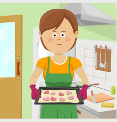 cute young woman baking cookies in kitchen vector image