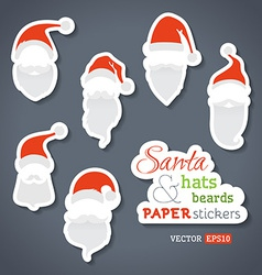 Paper santa stickers vector