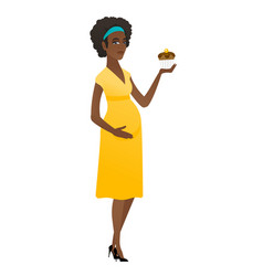 Pregnant woman holding a cupcake vector