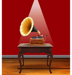Retro grammophone on table vector