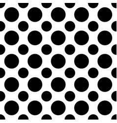 Seamless black and white polka dot pattern - vector