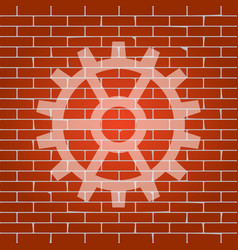 Gear sign whitish icon on brick wall as vector