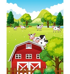 Farm scene with cows and barn vector image