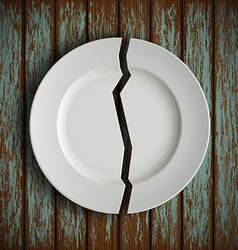 Broken white plate on old wooden table vector