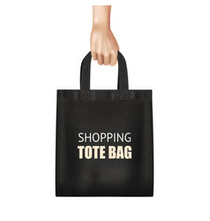 Hand holding black shopping bag realistic vector