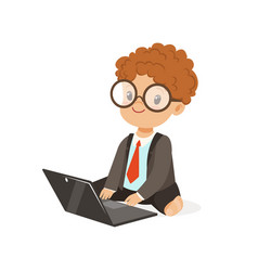 cute little boy businessman working on his laptop vector image