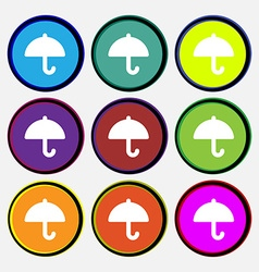 Umbrella icon sign nine multi-colored round vector