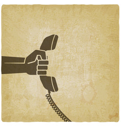 Hand with telephone handset vector