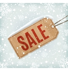 Sale paper tag on background with snowflakes and vector