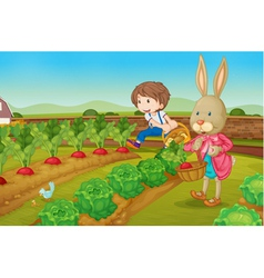 Bunny and boy in the garden vector image vector image