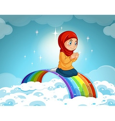 Muslim girl praying over the rainbow vector image