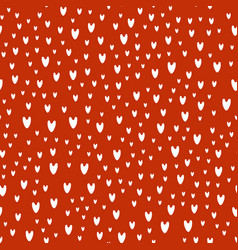 Pattern of white hearts on red background vector