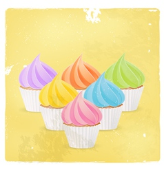 Cupcake with colourful icing vector