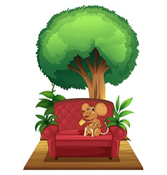 A chair under the tree with a mouse vector