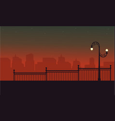 Street lamp with fence scenery at night vector