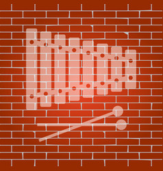 xylophone sign whitish icon on brick wall vector image vector image