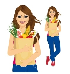 Young woman carrying grocery paper bag vector