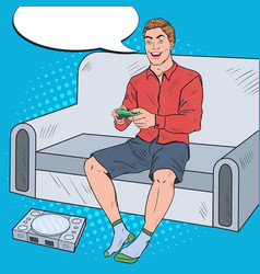 Pop art guy playing videogame on a game console vector
