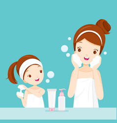 mother and daughter cleaning and care her face vector image