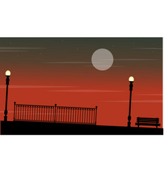 Silhouette of fence with lamp on the street at vector