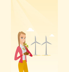 Woman holding small plant vector