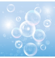 Group of transparent spheres on blue background vector image