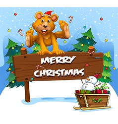 A playful bear playing near the christmas vector