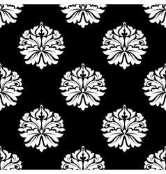 Arabesque pattern of floral motifs on black vector