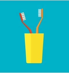 Tooth brush in a yellow cup vector