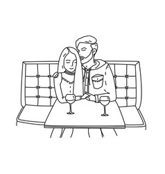 Young couple sits in a cafe and drinks wine vector