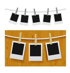 Photo frames with pins on rope vector