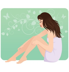 Beautiful young woman in towel sitting on the floo vector image