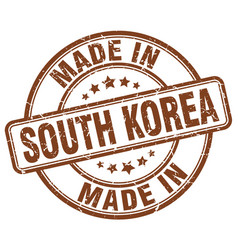 Made in south korea brown grunge round stamp vector