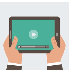 Businessman holding tablet computer with video pl vector
