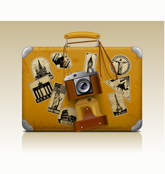 Old small threadbare suitcase with a retro photo vector