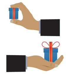 Hand with a box with a gift vector image