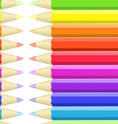 Seamless background of colored crayons vector