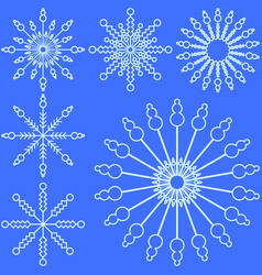 set of light blue snowflakes on a blue background vector image