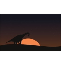 Silhouette of brachiosaurus on hill scenery vector