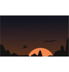 At sunset pterodactyl landscape of silhouettes vector