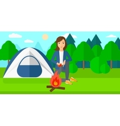 Woman kindling fire vector