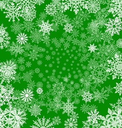 Christmas background of snowflakes in green colors vector
